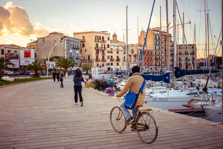 palermo   italy: PALERMO, ITALY - MARCH 14, 2015: People walking and cycling along La Cala bay in Palermo, Italy Editorial