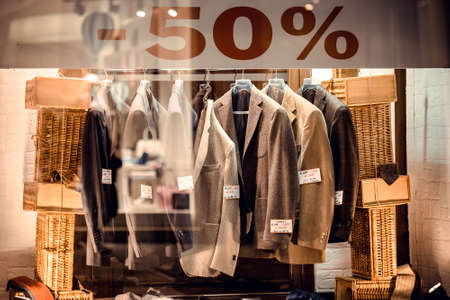 NAPLES, ITALY - MARCH 19, 2015: Mens fashion store window with jackets at night in Naples, Italy