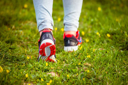 Walking or running legs on trail, adventure and exercising concept