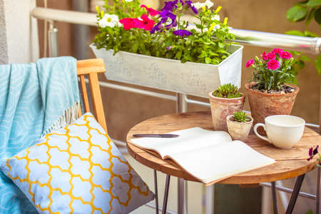 garden: Beautiful terrace or balcony with small table, chair and flowers