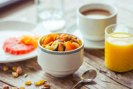healthy breakfast: Healthy breakfast on wooden table - cereals, fresh orange juice, citrus and coffee