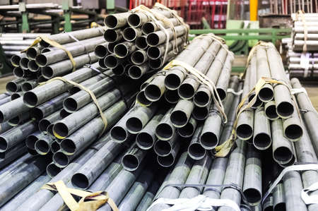 metal pipes: Stacked aluminum metal pipes Stock Photo