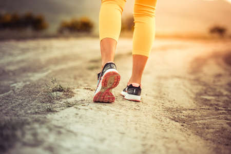 Walking or running legs on trail, adventure and exercising concept photo