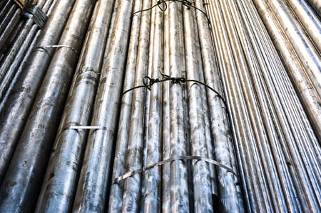 metallurgic: Stacked aluminum metal pipes. Heavy industry production