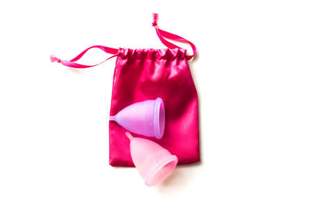 menstrual: Two menstrual cups with cotton bag isolated on white background