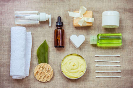 Different cosmetic bottle containers and accessories for facial care from top Foto de archivo