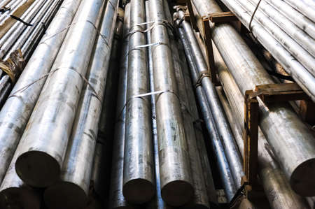 leaden: Stacked aluminum metal pipes Stock Photo