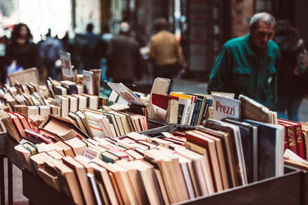 NAPLES, ITALY - MARCH 20, 2015: Second hand book stalls of the book market in the historical center of Naples, Italy