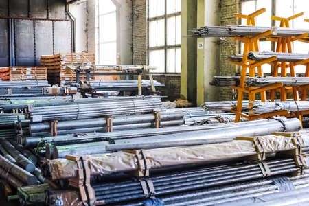 aluminum sheet: MOSCOW, RUSSIA - CIRCA MAY, 2011: Stacked aluminum rods in russian smelting plant Alfa-Metal, based in Moscow, Russia