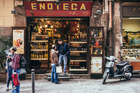 NAPLES, ITALY - MARCH 20, 2015:  Range of the wine shop on the old popular street in Naples, Italy Editöryel