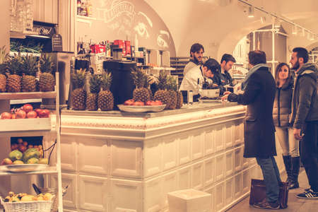 neapolitan: NAPLES, ITALY - MARCH 20, 2015: People eating at small cafe in Naples, Italy. Toned picture