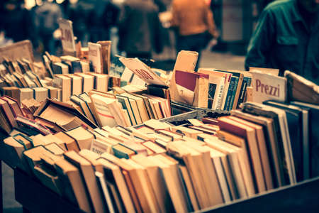 italy culture: NAPLES, ITALY - MARCH 20, 2015: Second hand book stalls of the book market in the historical center of Naples, Italy. Toned picture