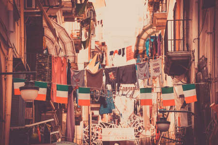 napoli: NAPLES, ITALY - MARCH 20, 2015: Classical romantic small street with italian flags in Naples, Italy. Naples is the the third-largest city in Italy with about 1 million residents. Toned picture Editorial