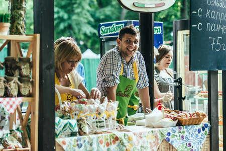 popup: KIEV (KYIV), UKRAINE - MAY 26, 2015: Vendors on a pop-up food market in Kiev, Ukraine