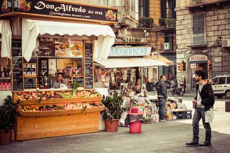 NAPLES, ITALY - MARCH 20, 2015: Small fast food cafe and shop in the historical center of Naples, Italy Editorial