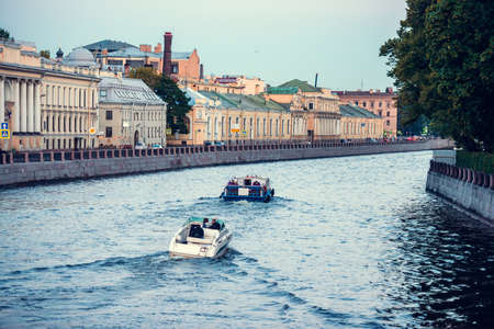 nights: Small boats on Fontanka river during white nights in Saint Petersburg, Russia Stock Photo