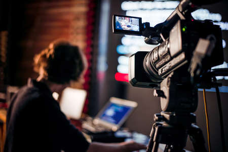media equipment: Filming creative video footage with professional video camera during the night