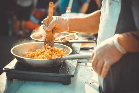 Meat on frying pan. Street food and outdoor cooking concept Toned picture Imagens - 50536852