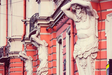 telamon: Granite telamons as a detail of facade decoration of Beloselsky-Belozersky palace in Saint Petersburg, Russia