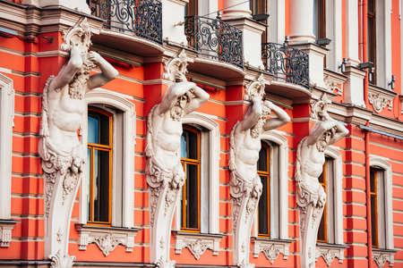 telamon: Granite telamons as a detail of facade decoration of Beloselsky-Belozersky palace in Saint Petersburg, Russia