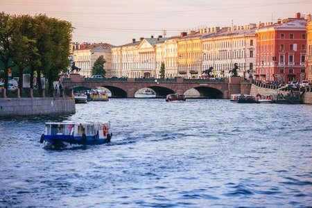 river: Anichkov Bridge on Fontanka river in Saint Petersburg, Russia. Toned image