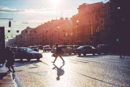 People crossing Nevsky prospect. Sunny evening in Saint Petersburg, Russia. Toned picture