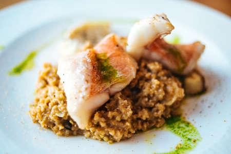 spelled: Porch fish fillet with spelt (spelled) porridge. Old russian cuisine