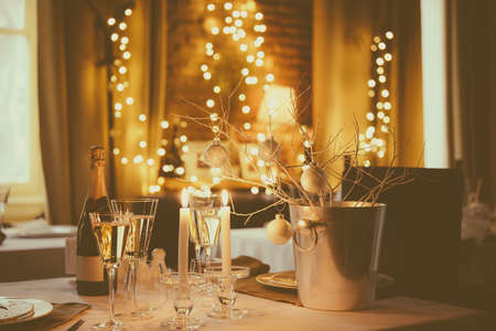christmas room: Christmas or New Year party table. Toned image Stock Photo