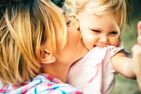 the mother: Young beautiful mother has fun with her daughter Stock Photo
