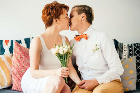 romantic sex: Beautiful lesbian couple kissing while celebrate their wedding. Gay marriage concept.