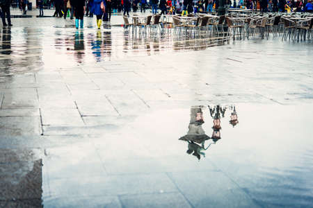 san marco: The reflection of the lion - symbol of Venice is seen in the puddle at San Marco square in Venice, Italy