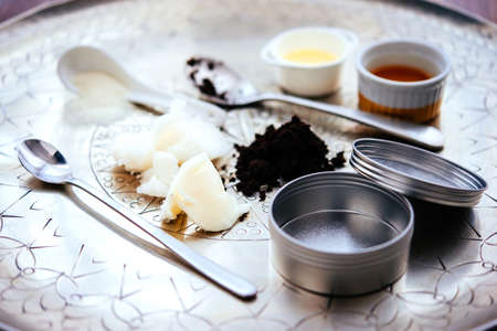Handmade cosmetic ingredients - coconut and shea tree butter, olive oil, round coffee and sugar. Organic scrub and body cream.