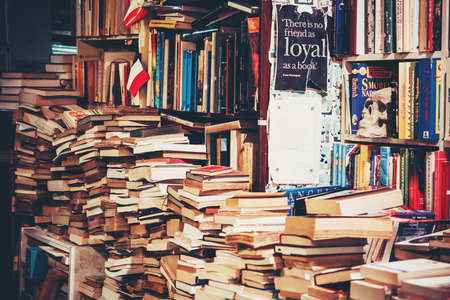 VENICE, ITALY - OCTOBER 12, 2015: Books are on sale in a secondhand bookshop in Venice, Italy. Toned picture