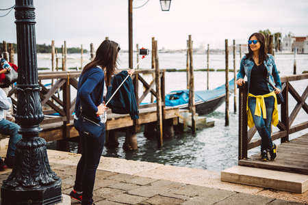 san marco: VENICE, ITALY - OCTOBER 12, 2015: Tourists are taking selfie near Grand Canal and San Marco square in Venice, Italy