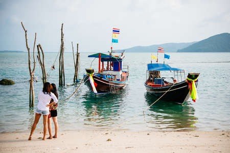 original: Colorful fishing boats in Thailand