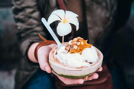 Coconut ice cream with nuts in Thailand Stock Photo - 56018746