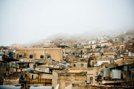 caltabellotta: View of village on a foggy day in Caltabellotta, Sicily, Italy. Stock Photo