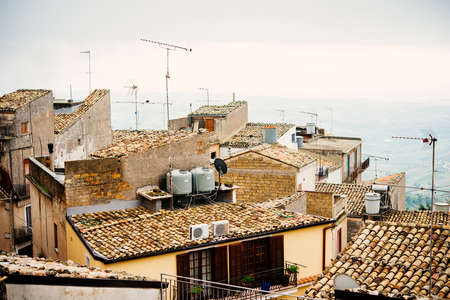 View of village on a foggy day in Caltabellotta, Sicily, Italy. Stock Photo