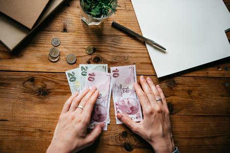 turkish lira: Hands holding turkish lira bills