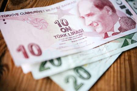 devaluation: Turkish lira bills on wooden table