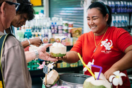 'koh samui': KOH SAMUI, THAILAND - MARCH 10, 2016: Street vendor sells coconut ice-cream in coconut shells at Koh Samui, Thailand. Editorial