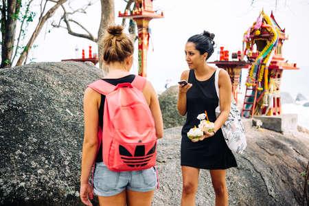'koh samui': KOH SAMUI, THAILAND - MARCH 10, 2016: Tourists enjoy coconut ice-cream at Koh Samui, Thailand. Editorial