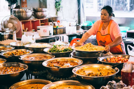 KOH SAMUI, THAILAND - MARCH 14, 2016: Different kinds of thai food on sale at one of the street markets at Koh Samui, Thailand. Selective focus