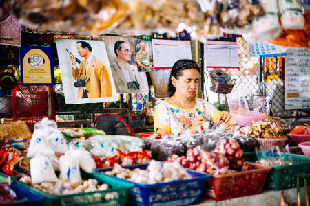 koh samui: KOH SAMUI, THAILAND - MARCH 14, 2016: One of the shop owners at one of the street markets at Koh Samui, Thailand.