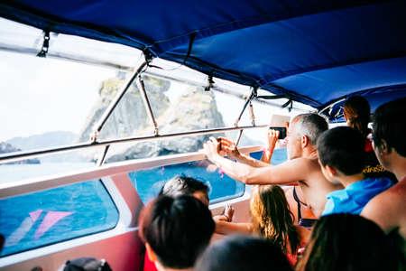 'koh samui': KOH SAMUI, THAILAND - MARCH 19, 2016: Tourists make pictures of Angthong National Marine Park, Suratthani, Thailand. Selective focus Editorial