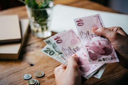 Hands holding turkish lira bills