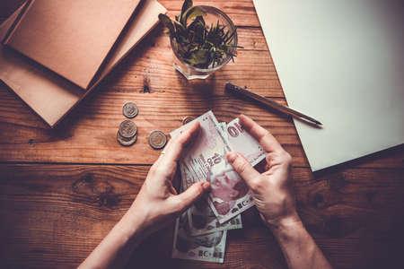 Hands holding turkish lira bills. Toned image. Selective focus