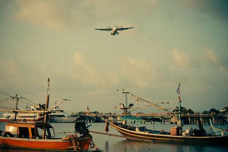 koh samui: A plane is landing at Koh Samui airport, Thailand. Toned image