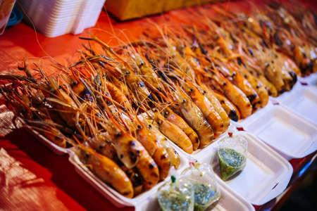 Grilled prawns on sale at street food market in Bangkok, Thailand.