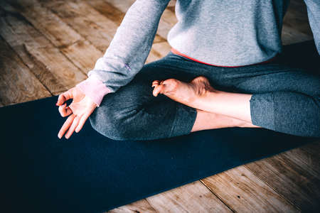 meditates: Young woman meditates while practicing yoga. Freedom concept. Calmness and relax, woman happiness. Stock Photo